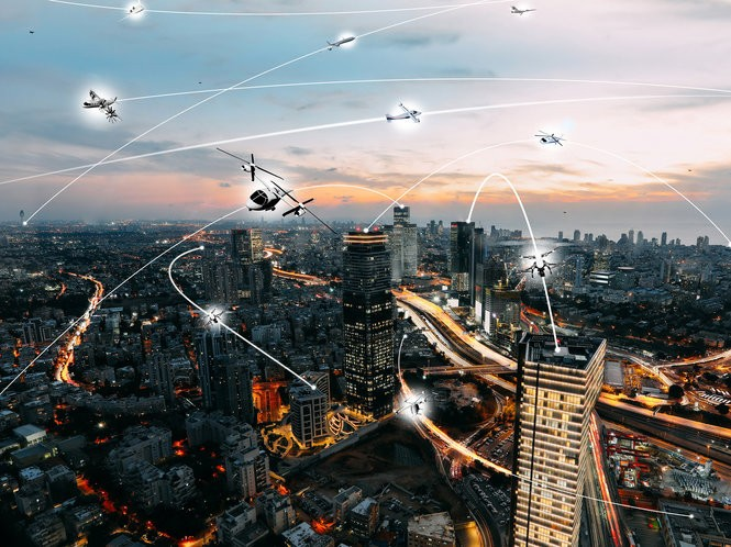 An artist's conception of an urban air mobility environment, where air vehicles with a variety of missions and with or without pilots, are able to interact safely and efficiently.