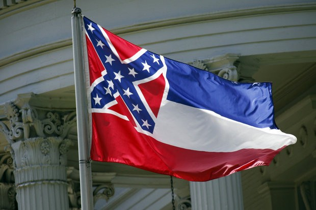 In this photo taken June 23, 2015, the Mississippi state flag is unfurled against the front of the Governor's Mansion in Jackson, Miss. (AP Photo/Rogelio V. Solis)