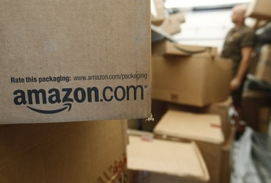 In this file photo, an Amazon.com package awaits delivery from UPS in Palo Alto, Calif. (AP Photo/Paul Sakuma, File)