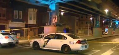 Philadelphia police investigate the shooting of an officer Sunday night, April 17, 2016, while trying to apprehend a suspect in a car break-in, authorities said.