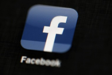 The Facebook logo is displayed on an iPad in Philadelphia.(AP Photo/Matt Rourke, File)