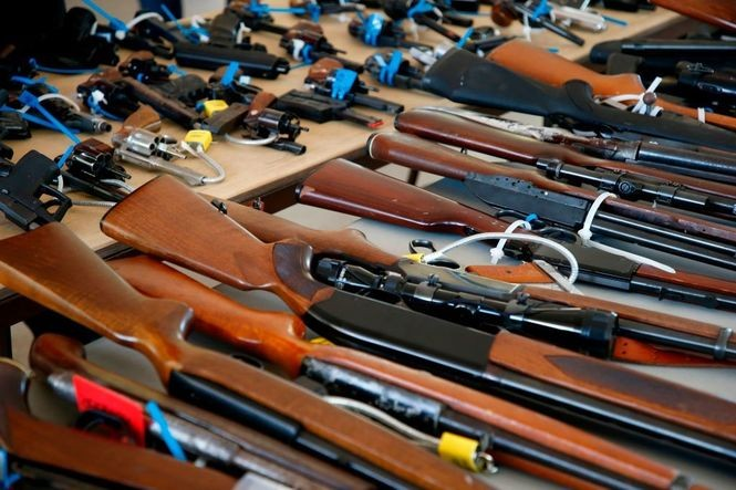 Guns sit on a table during a City of Miami gun buy-back event in Florida on March 17, 2018. The city bought over 100 guns, the most ever from one of its buy-back events. Up to $250 in gift cards was offered. It was the first in a series of buy-backs planned by Miami.
