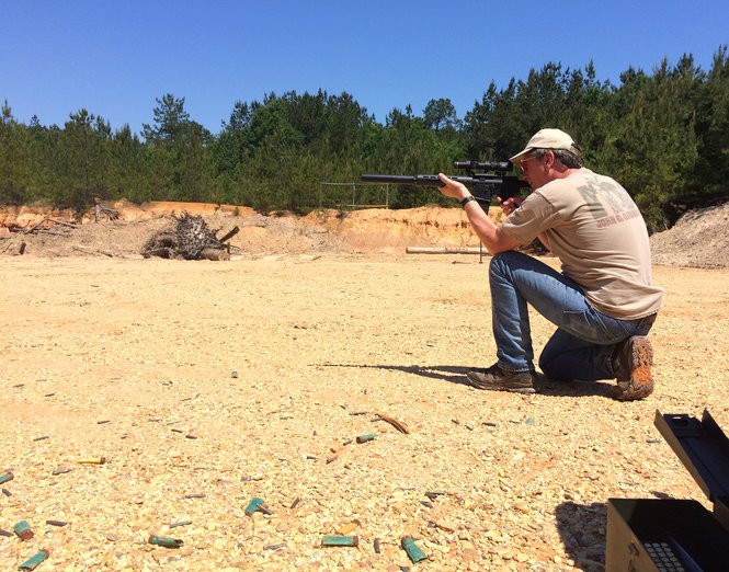 "Dan Zelenka, a participant in the ""Guns: An American Conversation"" project, takes part in friendly shooting competitions with his buddies at a quarry in Louisiana. Zelenka is a lawyer who came to the project with a broad knowledge of guns. (Ben Montgomery)"