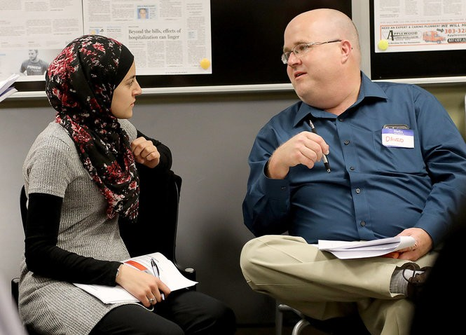 "David Preston (right) of Mobile, Alabama, speaks with Malak Wazne, a student from Dearborn, Michigan, during the ""Guns: An American Conversation"" workshop in Washington, D.C. (Seth Siditsky/Advance Local)"
