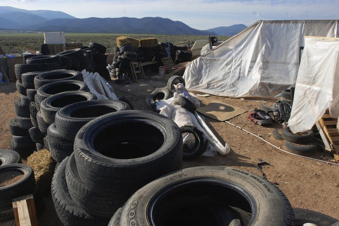 In this Aug. 10, 2018, file photo, is a makeshift living compound in Amalia, N.M.
