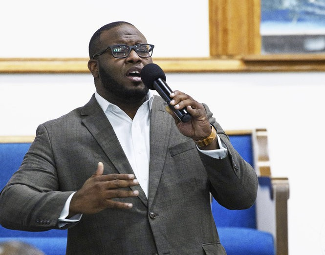 This Sept. 21, 2017, photo provided by Harding University in Search, Ark., shows Botham Jean leading worship at a university presidential reception in Dallas. Authorities said Friday, Sept. 7, 2018, that a Dallas police officer returning home from work shot and killed Jean, a neighbor, after she said she mistook his apartment for her own. (Jeff Montgomery/Harding University via AP)