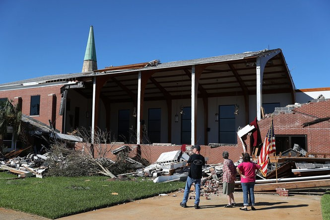 People look at the St. Andrew United Methodist Church in the wake of Hurricane Michael, Oct. 13, 2018 in Panama City, Florida. (Joe Raedle/Getty Images)
