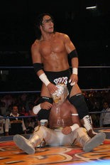In this April 13, 2007 photo, Mexican wrestler Pedro Aguayo Ramirez, known as Hijo del Perro Aguayo, top, tries to remove the mask of Mistico during a wrestling match in Mexico City.