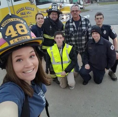 Carolyn Rizza, in foreground, with other members of the Amwell Valley Fire Co. including, from left, Tara Mershon, James Rizza, her father; Jason Rizza, her brother; Bob Jason, Mack Stehlin and Michael Rizza, her brother. (Courtesy of Carolyn Rizza)