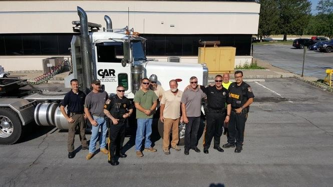 Several local business owners volunteered to help move a storage shed from the Clinton Township police headquarters to nearby Bundt Park. (courtesy photo)