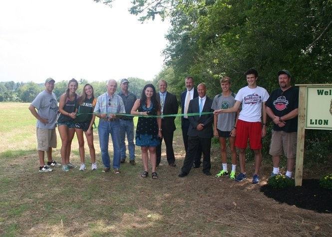 At the ribbon cutting are (from left) North Hunterdon High School's Girls Cross Country Head Coach Sean Walsh, cross country athletes Gabby Beneducci and Angela Kearsley, Clinton Township Mayor John Higgins, township Department of Public Works representative Jay Meixsell, Councilwoman Amy Switlyk, North Hunterdon Principal Greg Cottrell, Superintendent Jeffrey Bender, Assistant Superintendent Rich Bergacs, cross country athletes Ray Sellaro and Joe Gallo and Boys Cross Country Head Coach Thomas Higgins. (courtesy photo)