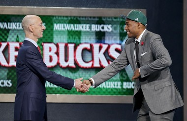 Jabari Parker of Duke is greeted by NBA Commissioner Adam Silver after being selected by the Milwaukee Bucks. (AP Photo/Kathy Willens)