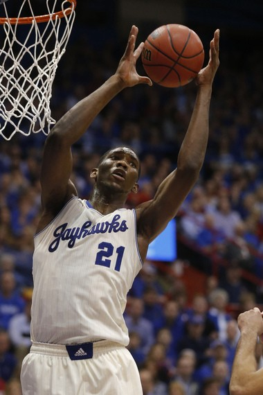 In this Feb. 24, 2014 file photo, Kansas center Joel Embiid (21) plays in the second half of an NCAA college basketball game against Oklahoma in Lawrence, Kan. Embiid is a possible pick in the 2014 NBA Draft, Thursday, June 26, 2014 in New York. (AP Photo/Orlin Wagner, File)