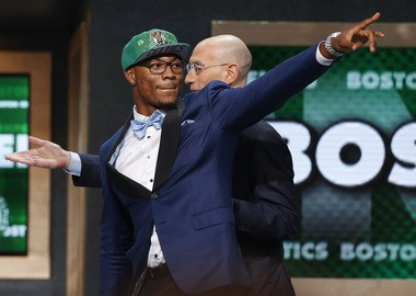 Oklahoma State's Marcus Smart, left, points to fans after being selected sixth overall by the Boston Celtics during the 2014 NBA draft, Thursday, June 26, 2014, in New York. (AP Photo/Jason DeCrow)