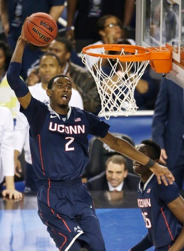 Connecticut forward DeAndre Daniels dunks the ball during the second half of the NCAA Final Four tournament college basketball semifinal game against Florida Saturday, April 5, 2014, in Arlington, Texas.