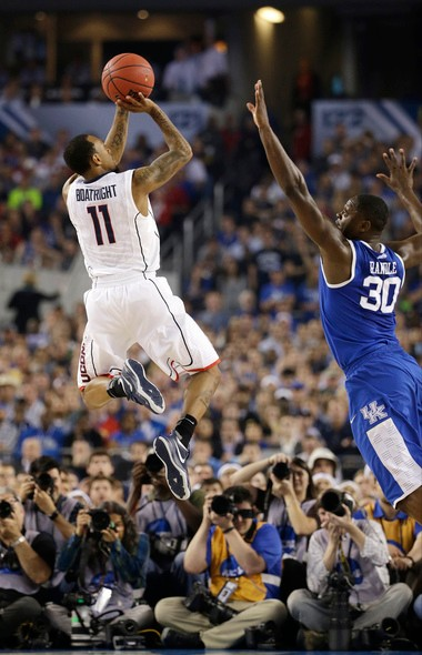 Connecticut guard Ryan Boatright, left, shoots over Kentucky forward Julius Randle during the second half of the NCAA Final Four tournament college basketball championship game Monday, April 7, 2014, in Arlington, Texas. (AP Photo/David J. Phillip)