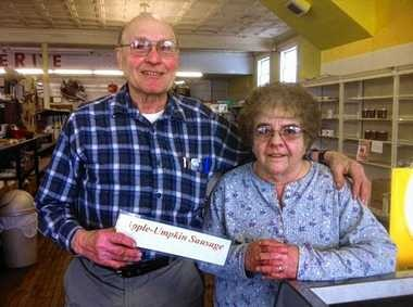 Jim and Barb Dourie of Dourie's Shop Wise in Wyoming (Wyoming County). They make apple-flavored breakfast sausage. From 'A Taste of Upstate New York' by Chuck D'Imperio.
