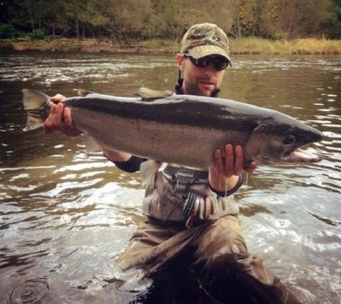 Brooks Robinson, of Syracuse, with a nice steelhead he caught and released on the Salmon River.