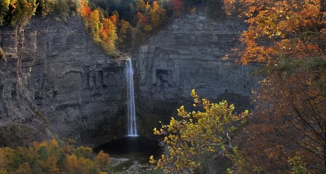 Autumn colors surround Taughannock Falls inside of Taughannock Falls State Park, located near Trumansburg.