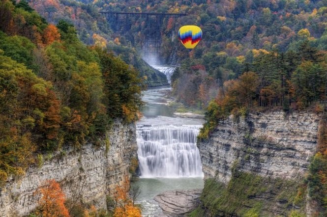 Balloons Over Letchworth hot air balloon flying over the Middle Falls at Letchworth State Park. Taken from Inspiration Point.