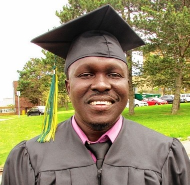 James Kiki, a refugee from South Sudan, upon his graduation from SUNY Oswego in 2013.