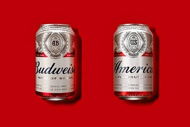 """This photo provided by Anheuser-Busch shows a normal Budweiser can, at left, and at right, a can with the new """"America"""" packaging. Budweiser, now owned by Belgium's AB Inbev, will rename its beer """"America"""" during the summer of 2016. (Martin Wonnacott/Courtesy of Anheuser-Busch via AP)"""