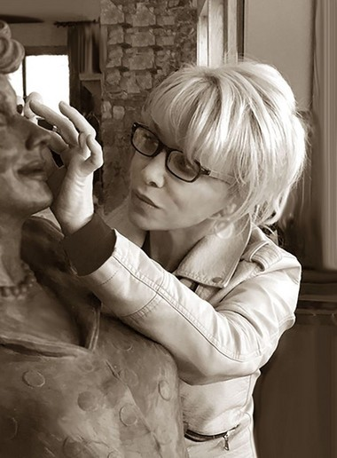 Former Syracuse sculptor Carolyn Palmer shared this photo of herself working on a new Lucille Ball statue.