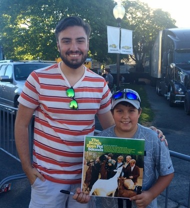 Braeden Proud, 10, of Oswego, waits for Brian Wilson at the NYS Fair, hoping for an autograph.