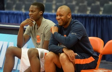 Syracuse assistant coach Adrian Autry and Tyler Roberson take a break from workouts before the Orange's game against Clemson at the Carrier Dome Feb. 9, 2014.
