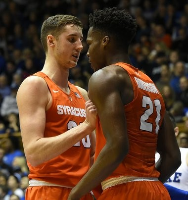 Syracuse forward Tyler Lydon (20) congratulates teammate Tyler Roberson after he scores during a game against Duke on Jan. 18, 2016, at Cameron Indoor Stadium.