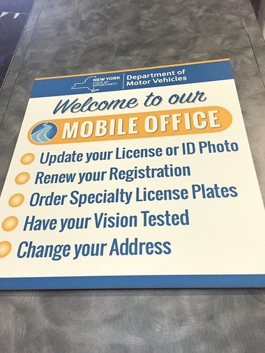 Signs at the Department of Motor Vehicles booth at the New York State Fair tell you