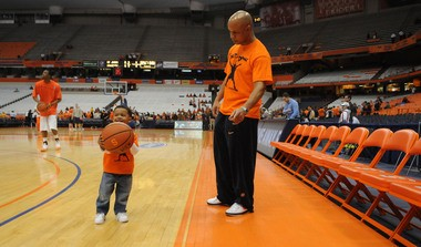 Syracuse Orange men's assistant basketball coach Rob Murphy brings his son Rob, Jr. to the court before the Orange's game against St. John's. March 3, 2010.