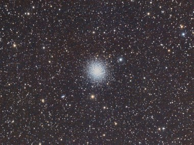 M13 through a medium-sized telescope.