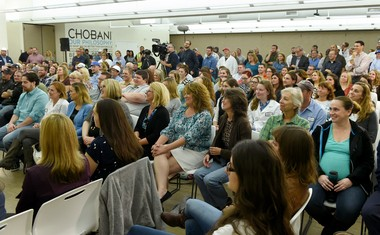 Employees at the Greek yogurt company Chobani, based in South Edmeston, N.Y., listen as founder Hamdi Ulukaya announces a 6-week paid family leave plan for employees Wednesday.