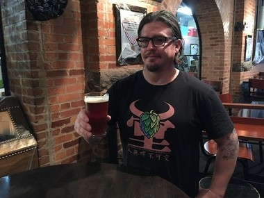 Empire Brewing Co.'s Tim Butler holds a pint of Apple Harvest Ale brewed by Empire Farmstead Brewery in Cazenovia using apples grown and pressed at Beak and Skiff Apple Orchards in LaFayette.