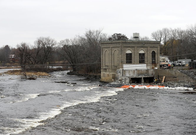 This Thursday, Nov. 17, 2016 photo shows the decommissioned powerhouse for a hydroelectric dam on the St. Regis River in Hogansburg, N.Y. A century after the first commercial dam was built on the St. Regis River, blocking the spawning runs of salmon and sturgeon, the river once central to the traditional culture of the Mohawk Tribe along New York's northern border is flowing freely again. (AP Photo/Mike Groll)