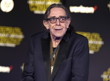 """In this Dec. 14, 2015, file photo, Peter Mayhew arrives at the world premiere of """"Star Wars: The Force Awakens"""" at the TCL Chinese Theatre in Los Angeles."""