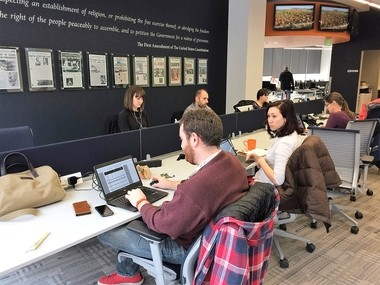 Reporters and editors work at Syracuse Media Group's office in downtown Syracuse. The company is changing its name to Advance Media New York.
