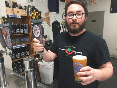 "Isaac Rubenstein of Middle Ages Brewing Co. in Syracuse with Single Batch #8, a 'New England-style"" India Pale Ale."