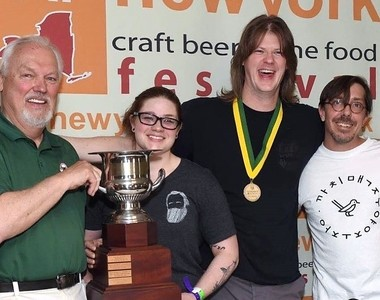 TAP New York president Bill Woodring, left, awards the 2017 Governor's Cup for Best Craft Beer in New York to Jeannie Alexander, Ryan Demler and Ethan Cox of Community Beer Works in Buffalo for The Whale Brown Ale.