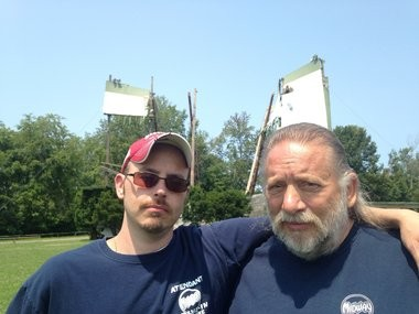 The Nagelschmidts, John Jr. and John Sr., at the ruins of the Midway Drive-In Theatre in Minetto, in this 2014 file photo. The elder John died in an accident April 23.