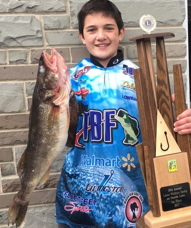"""Nick Nolan said he plans to put his $1.500 winner's check for winning the walleye derby """"in the bank for college."""""""