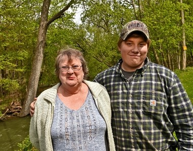 Louanne Caswell and Drayden George, both of Marcellus, stand by Nine Mile Creek where Drayden rescued Louanne after she fell into the creek last Friday evening. Photo taken May 9, 2017. Michael Greenlar | mgreenlar@syracuse.com