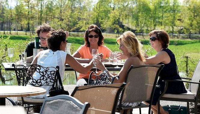 Visitors enjoy an afternoon of wine tasting at Owera Vineyards in Cazenovia.