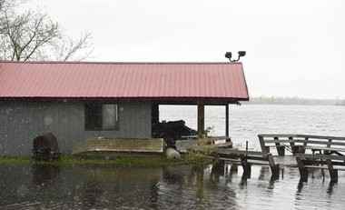 Rising waters at Sand Pond in Oswego County overwhelm a marina on Rt 15 in late May.