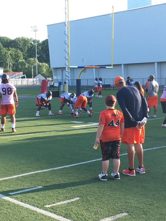 CJ watches drills with Syracuse director of player development Roy Wittke.