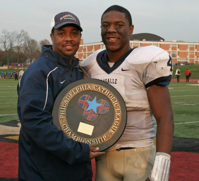 Syracuse linebacker Zaire Franklin with former coach and father figure Eric Taylor after La Salle won the Catholic League championship in 2012.
