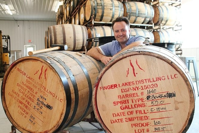 Owner Brian McKenzie with bourbon barrels at Finger Lakes Distilling, Burdett, N.Y.