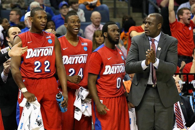 Dayton assistant coach Allen Griffin cheers on the bench against the Stanford Cardinal during a 2014 NCAA Tournament game.