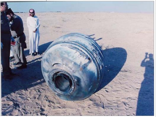 Saudi inspectors examining a crash-landed PAM-D module in 2001.